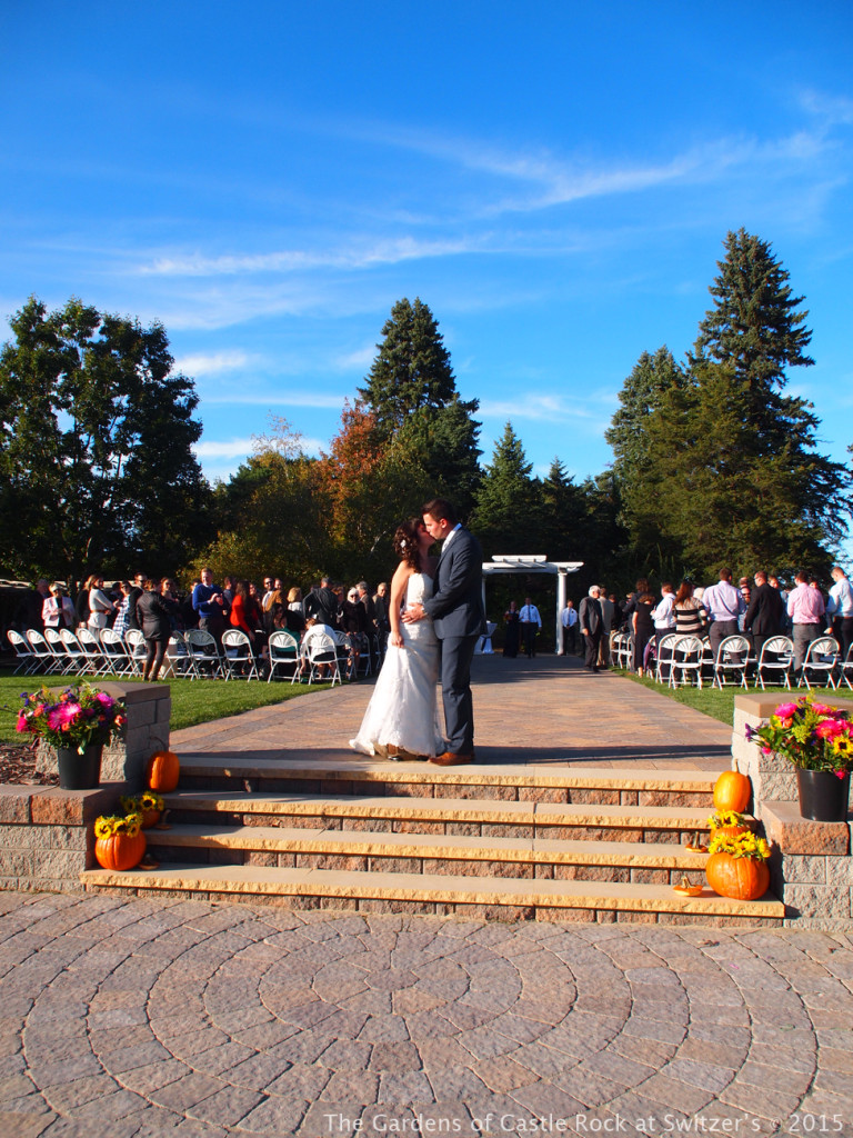 Savor the moment, one last kiss on the promenade! Sunny & Brian at The Gardens of Castle Rock ~ Weddings & Events - Beautiful Outside Fall Wedding