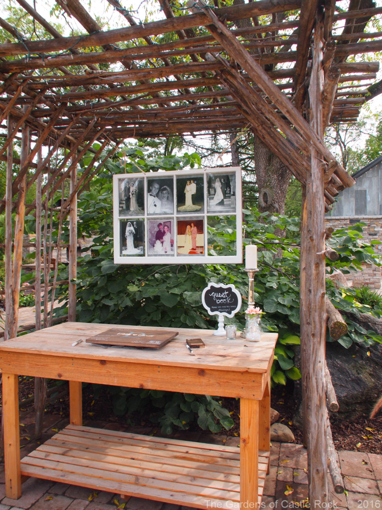 The Mid-Height Garden Table used for the guest book. Beth & Garett at The Gardens of Castle Rock ~ Beautiful Minnesota Wedding