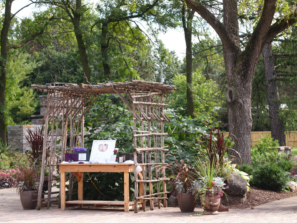 The Mid-Height Garden Table used for the guest book. Kristian & Zackary at The Gardens of Castle Rock ~ Minnesota Garden Wedding