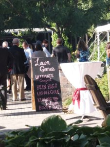 Jessica & Carson at The Gardens Of Castle Rock ~ Minnesota Outdoor Wedding - Lawn Games Sign