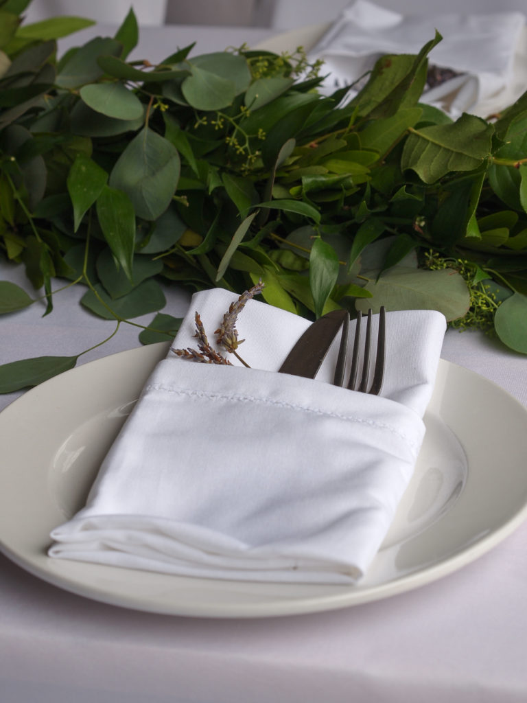 Lavender sprigs greet every guest at their place setting.