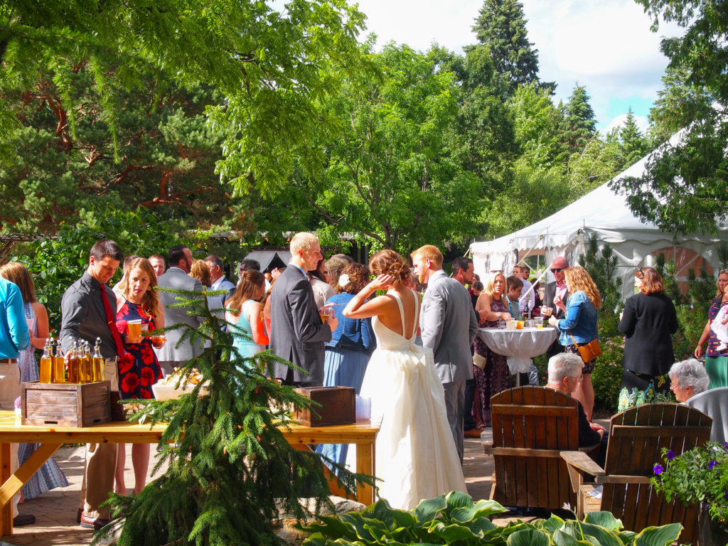 An informal and relaxed receiving line on The Garden's reception patio.